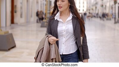 Stylish woman in an urban pedestrian mall - Stylish...