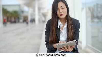 Stylish young woman using her tablet-pc - Stylish young...