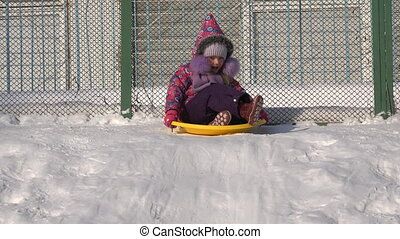 Child Ride on a Plate on Hill, Kid Sledding in Winter