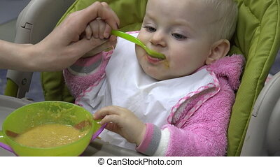 Little Baby Feeding with Spoon Closeup - Little Baby Feeding...