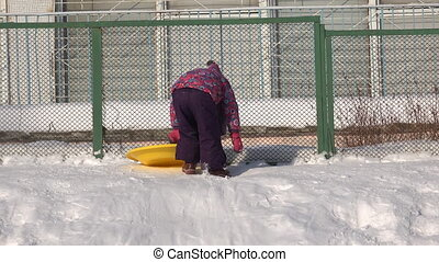 Child Ride on a Plate on Hill, Kid Sledding in Winter -...