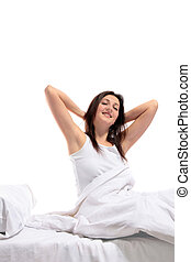 Well rested woman - A well rested woman sitting on her bed....