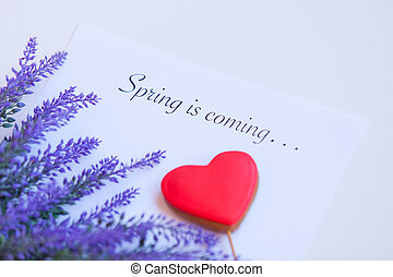 Paper with words Spring in coming and flower with heart...