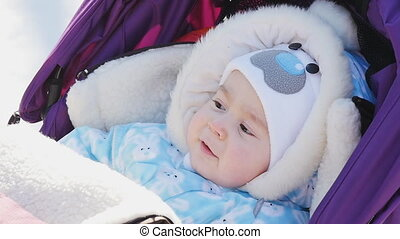 Portrait of cute baby in pram at winter - Portrait of cute...