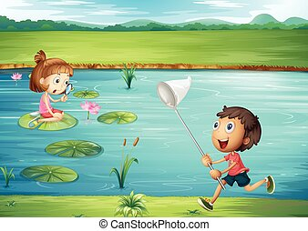 Boy and girl playing by the pond
