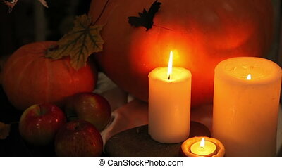 Candles and pumpkin on Halloween table