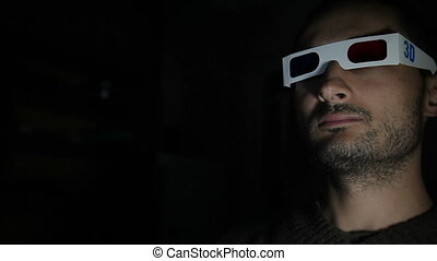 Man's Face Lit Up In Dark - man's face in 3D glasses Lit Up...