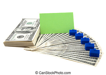 Spread of cash on white background with blank card for text