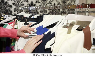 beautiful woman shopping in clothing store