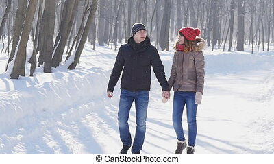 Couple holding each others hands, the winter goes on the...
