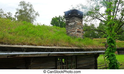 quot;chimney of house with green grass rooftop smoking,...