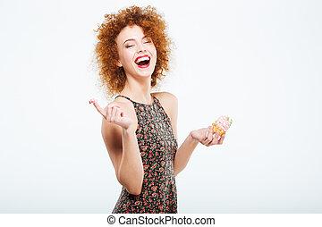 Laughing woman eating cake - Laughing redhead woman eating...