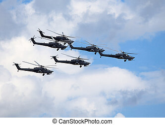 Combat helicopters in flight - Perform flight by the modern...