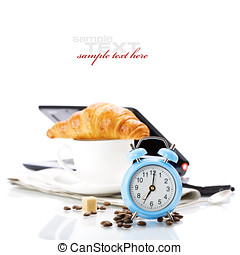 Breakfast concept - Alarm clock and breakfast on white with...