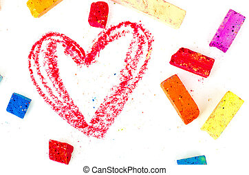 Bright pieces of chalk with the read heart drawn on white....