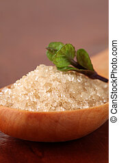 Cane sugar in a wooden spoon