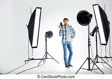 Photographer standing with photo camera - Full length...