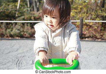 Japanese baby girl on the seesaw 1 year old