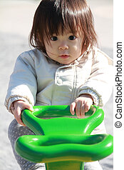 Japanese baby girl on the seesaw (1 year old)
