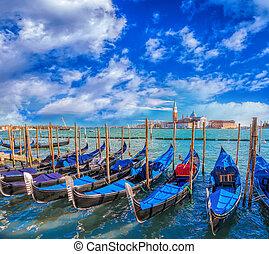 Gondolas in Venice against San Giorgio Maggiore church in...