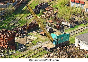 Train crane railcar. Hydraulic crane mounted on a railroad...