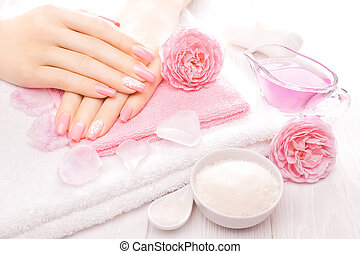 french manicure with essential oils, rose flowers. spa -...
