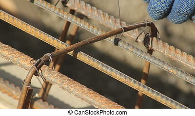 hand binds the reinforcing cage for bulding