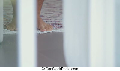 Man bare foot on a rug in the room - Man bare foot on rug in...