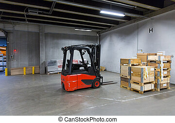 forklift loader and boxes at warehouse