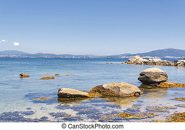 Rocky coastline - Rocks on the sea in Arousa Island