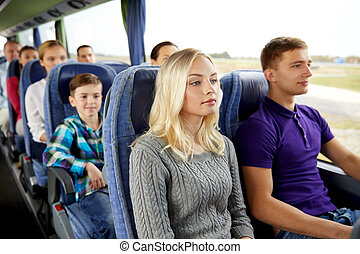 happy couple or passengers in travel bus - transport,...