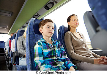 happy family riding in travel bus - travel, tourism, family,...