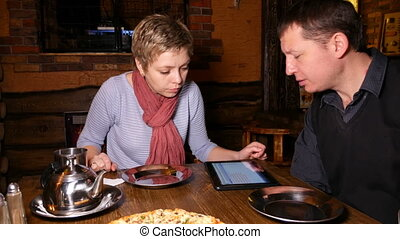 Man and woman business partners chatting in cafe -...
