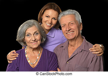 Happy senior parents with daughter