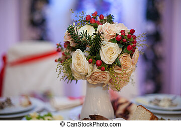 Closeup of white roses wedding bouquet at reception