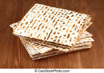 Matzah on wooden table - matzo flatbread for Jewish high...