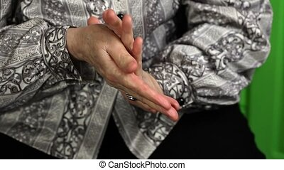Female smearing hands with hand
