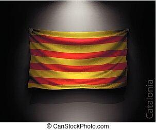waving flag catalonia on a dark wall with a spotlight,...