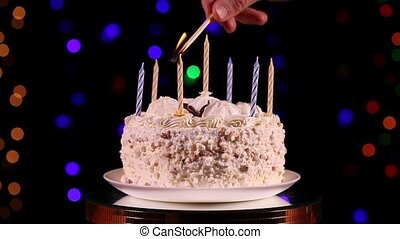 Happy birthday to you - Ones hand lit a candles of the...