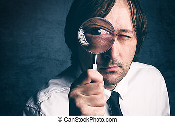 Businessman with magnifying glass, tax inspector doing...