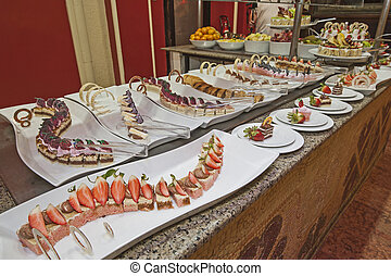 Selection of desserts on display at a restaurant buffet -...