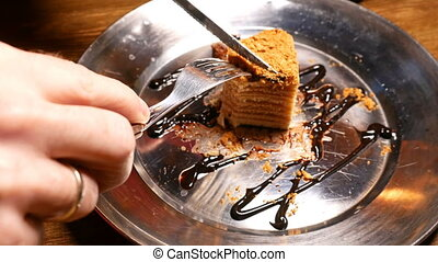 Cake being cut with fork and knife Close up shot - Piece of...