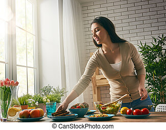 woman prepares the dinner - a young woman prepares the...