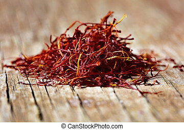 saffron threads - a pile of saffron threads on a rustic...