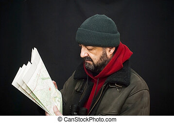 Portrait of adventure man with map and extreme explorer gear...