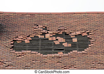 damaged roof with a large hole - roof of an old derelict...
