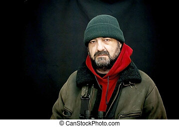 Portrait of adventure man with extreme explorer gear over...