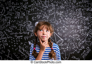 Girl thinking about mathematical - Thinking girl in blue...