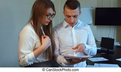 An attractive young businessman and businesswoman meet to...