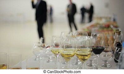 Glasses of wine, drinks are on the buffet table